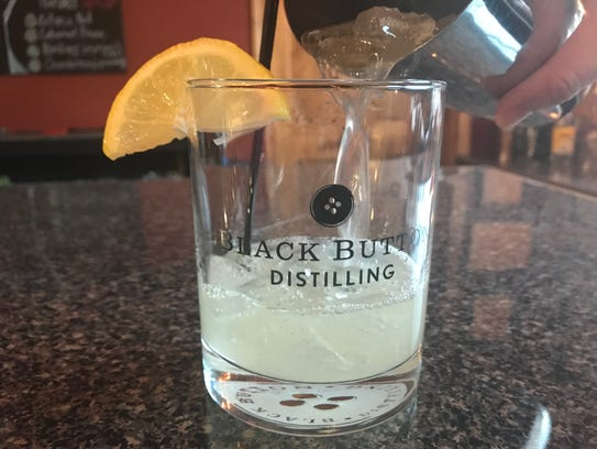 A Bee's Knees being mixed at Black Button Distilling