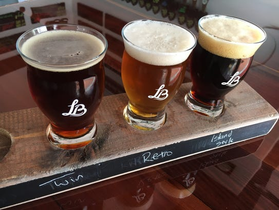 Tasters are seen at Leashless Brewing in downtown Ventura.