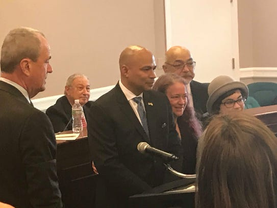Gov.-elect Phil Murphy, left, swears into office Parsippany