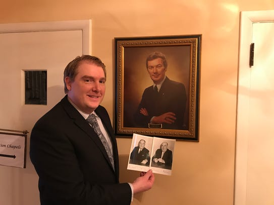 Representing three generations, Paul McCorry holds