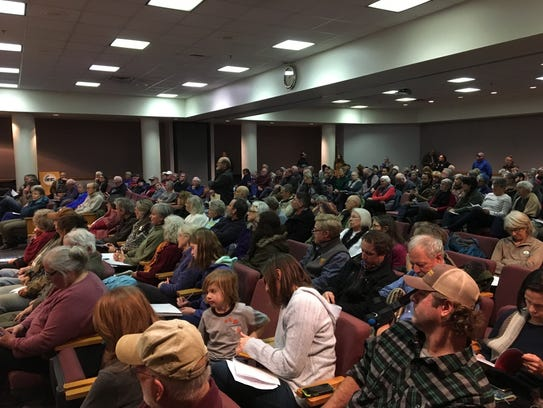 Over 250 people listen on at a Board of Zoning Appeals meeting in Verona, Va., on Thursday, Jan. 4, 2018, as the board considers whether to grant a special use permit to the Atlantic Coast Pipeline for a storage yard in Churchville, Va.