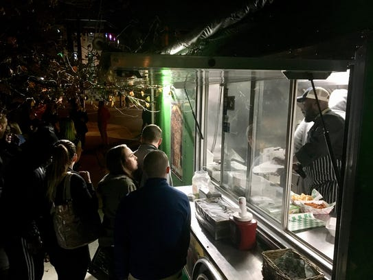 Smyrna-based chef Willie Enchill and his Delicious Craving food truck sold late-night hot food in the early morning hours of Sunday, Dec. 3 in Wilmington's Trolley Square.