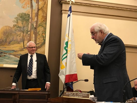 Arthur Dawson looks at the gift he's received for his 12 years of service on the Glen Ridge Borough Council on Monday, Jan. 8, 2018.