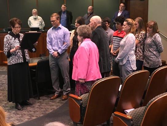 Family members of Charlotte Bouillon listen as jury