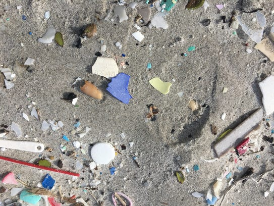 Plastic bits littered Cocoa Beach Friday.