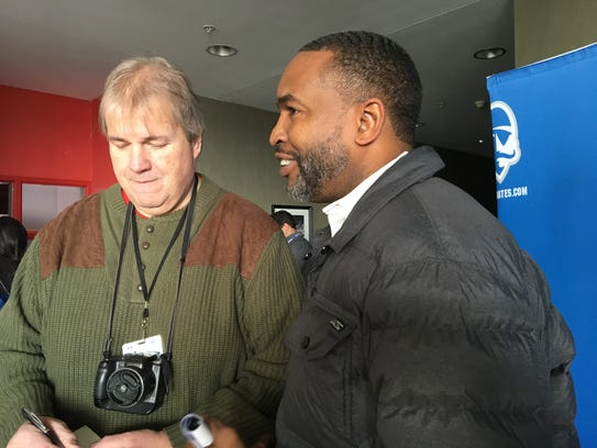 Seton Hall great Terry Dehere (right) speaks with reporters