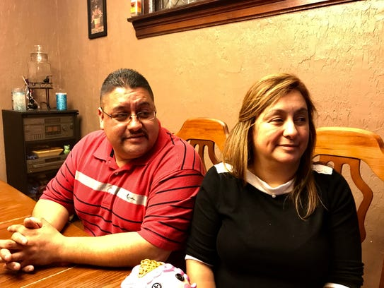 Jorge Garcia, 39, of Lincoln Park with his wife, Cindy Garcia, in a Detroit home on Jan. 14, 2018, on the eve of him being deported to Mexico.