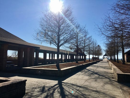 Visitors to Fontainebleau State Park can sit under the shade leading up to Lake Pontchartrain.