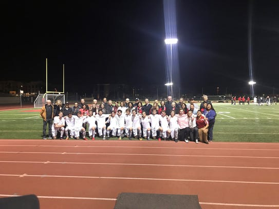 Brophy Prep seniors pose with their parents during