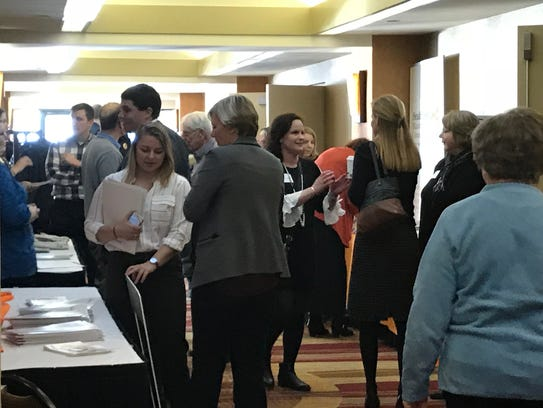 People mingle during a break for the Vision 2022 Summit