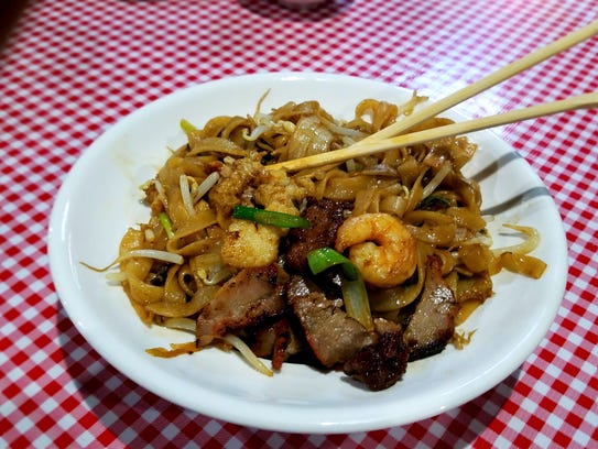 Chinese dishes, include a whole page of noodle options. These wide rice noodles, or chow ho fun, have been stir-fried with beef, pork, chicken and shrimp.