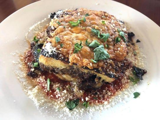 The moussaka ($14) is layers of potato, zucchini, eggplant,