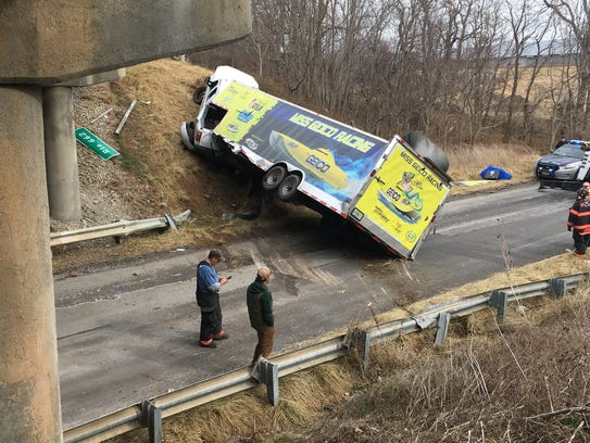 The truck and trailer owned by the Miss GEICO Offshore Racing Team lie across Stover School Road in Greenville after it left I-81 on Monday. The driver of the truck, Rusty Ward, 44, of Inman, S.C., was seriously injured in the crash.