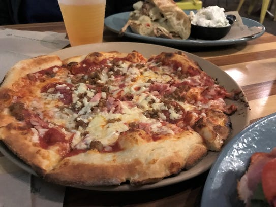 Cafe Literato's carne pizza basically is a meat-lover's