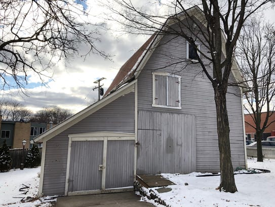 A free barn, seen here Jan. 30, 2018, was offered in downtown Farmington. It's to be moved to the Oakland County Pioneer and HIstorical Society in Pontiac.