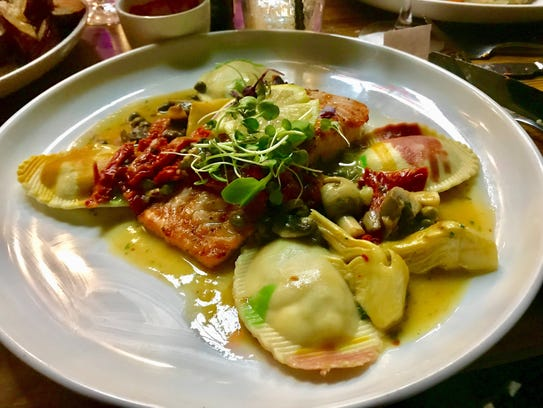 A salmon special with lobster ravioli in a caper-white-wine