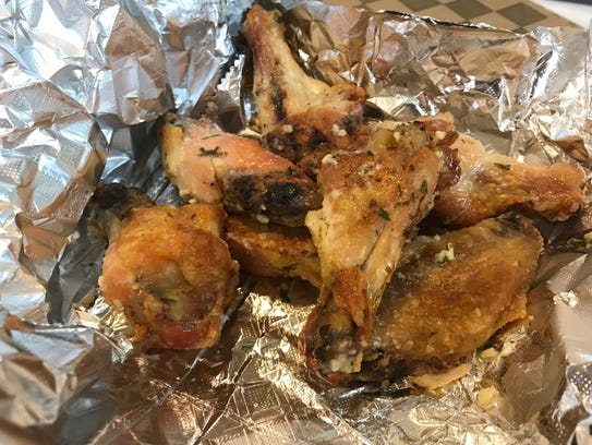 Chicken wings are baked in pizza ovens at Mama Minto's