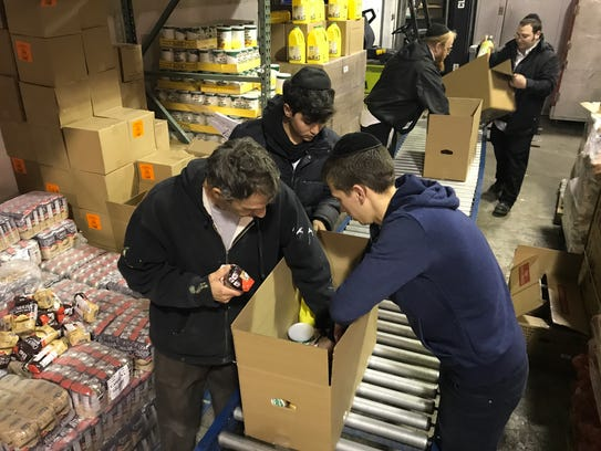 Tomchei Shabbos food bank volunteers Anthony Silvester,