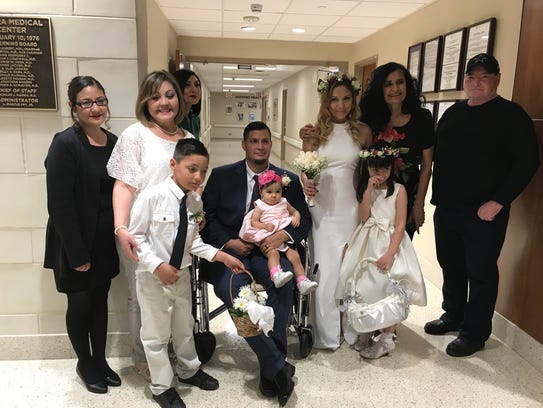 The bride and groom took pictures with family after