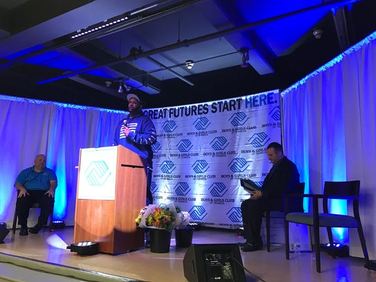 Yankees pitcher CC Sabathia speaks at the opening of