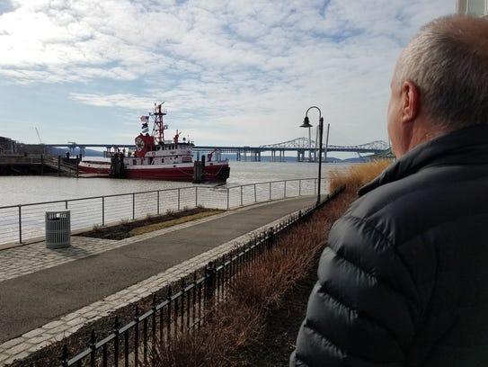 Michael Aaronson looking to the Hudson River from his