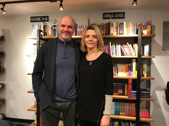 Nadege Nicoll and her husband Stuart attend a soft opening event at The Book House on Essex Street in Millburn on Feb. 2. Nadege owns The Book House.
