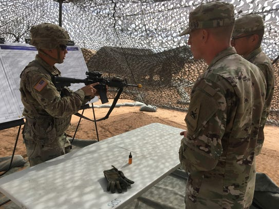 Cpl. Kenneth Ciszek, left, with 1-67 Armor with 3rd Brigade, practices putting an M4 rifle through various checks as part of the Expert Infantryman Badge testing at Fort Bliss. Staff Sgt. Russell See, foreground, observes and offers pointers.