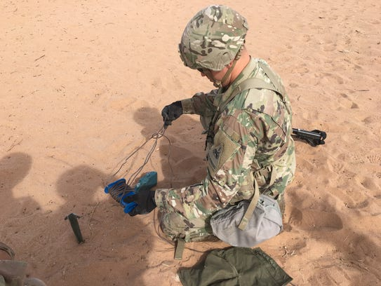 A soldier practices putting together a Claymore mine