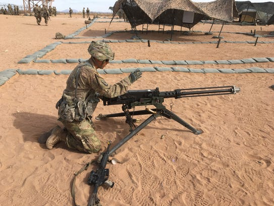 A soldier checks the functions of a .50 caliber machine