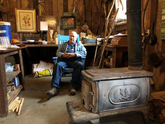 Master gardener John Coykendall relaxes in the BlackBerry Farm garden shed as he talks heirloom seeds with Robert St. John.