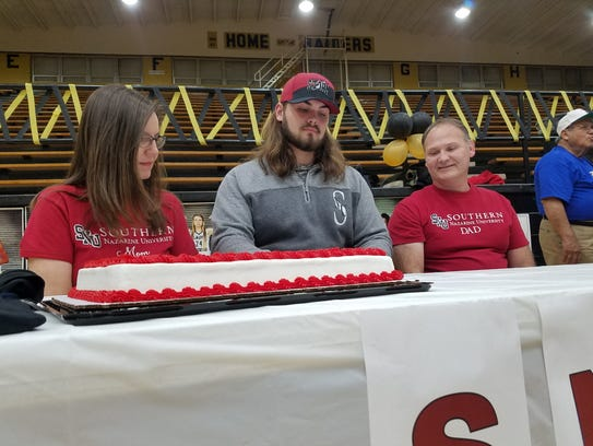 Rider senior Caleb Hughes signs to play football at