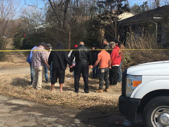 Family members pray on scene after two men and child