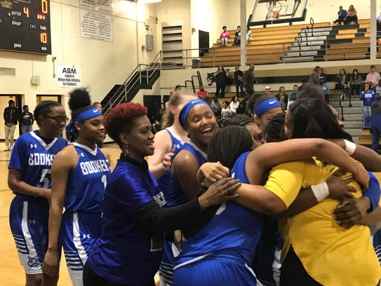 Booker T. Washington High girls celebrate their District
