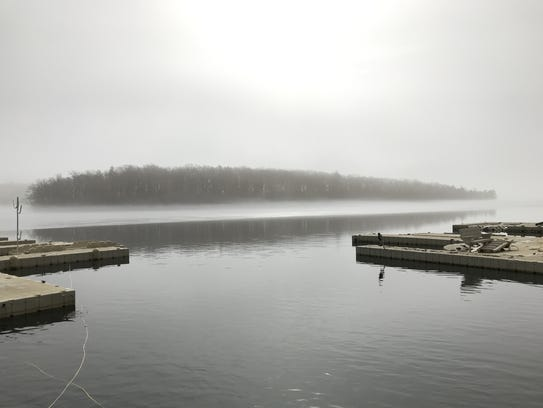 Fog lifts off a thawingGreenwood Lake in West Milford,