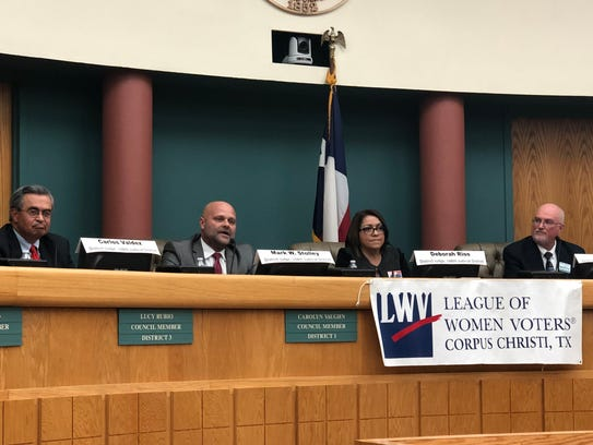 Candidates for the 148th District Court speak at a