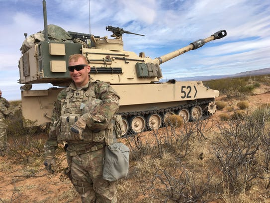 Capt. Alan Bauerly, commander of Beast Battery, 4-1 Field Artillery, stands in front of a Paladin. Bauerly is a big believer in using live fire training as a way to create better teamwork.
