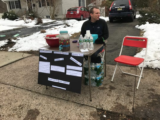 Michael Lawson and his sons held a lemonade stand to