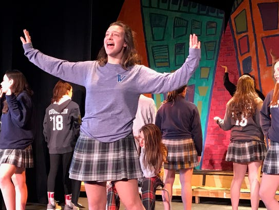 Julia Howe, center, plays Tracy Turnblad in School