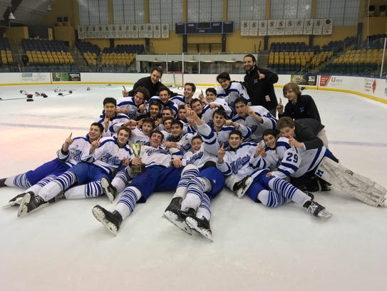 The Millburn Millers celebrate winning the Kelly Cup