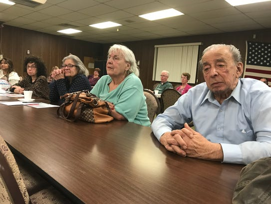 Residents listen to a Belleville Police Department