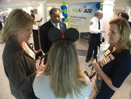A Montgomery Area Chamber of Commerce official wears Mickey ears at the announcement of direct air service to Orlando at the Montgomery Regional Airport.