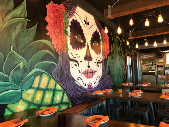 A colorful mural is painted on a wall at La Pina, a