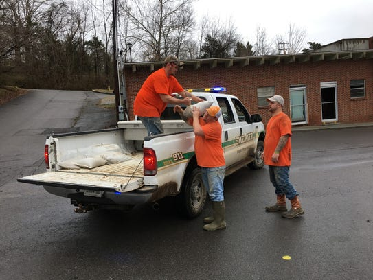Work crews from the Houston County Jail filled and