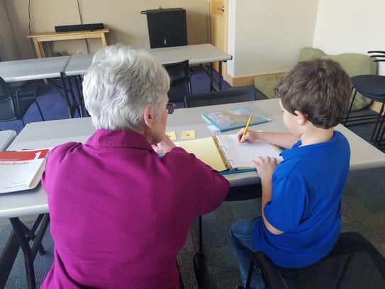 Third grade student Nolan Lozano working with tutor,