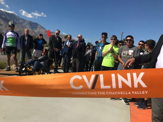 Participants gather for the CV Link ribbon cutting