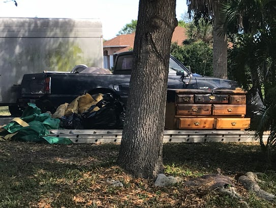 A burned dresser and mattress were in the driveway