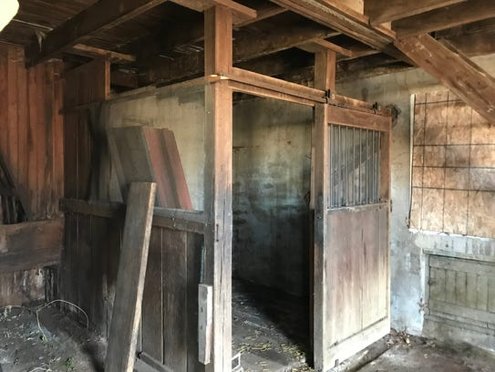 The single horse stall inside the barn building that