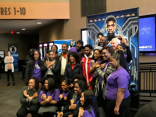 Fans pose with Big Sean at Emagine Royal Oak at a screening