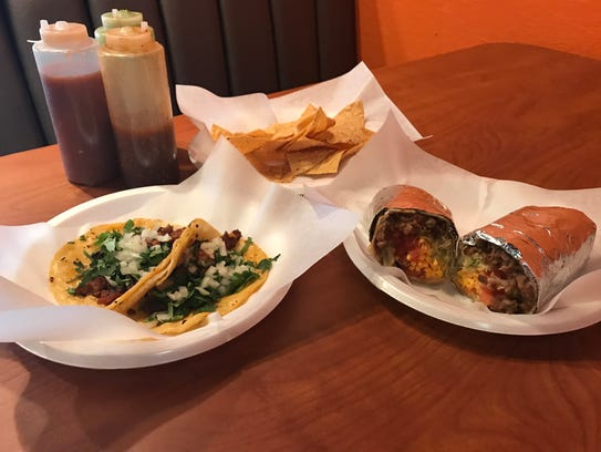 The steak burrito and tacos al pastor from Happy Burrito.