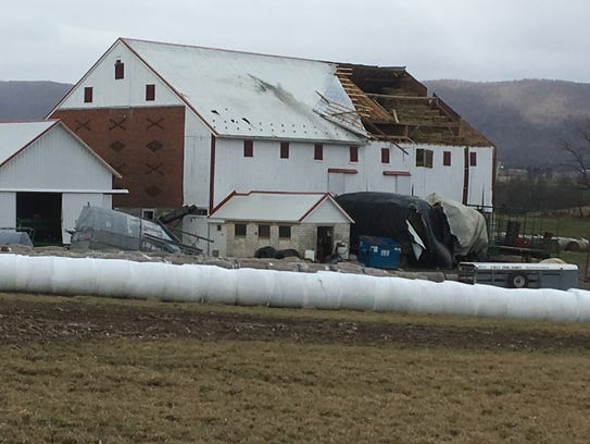 High winds tore off a section of a barn roof on Loudon Road, St. Thomas Township, on Friday.